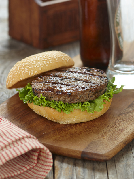 Dressing a burger with curly lettuce