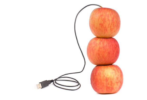 Three apples connected with a USB cable