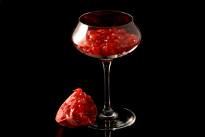 pomegranate seeds in a glass