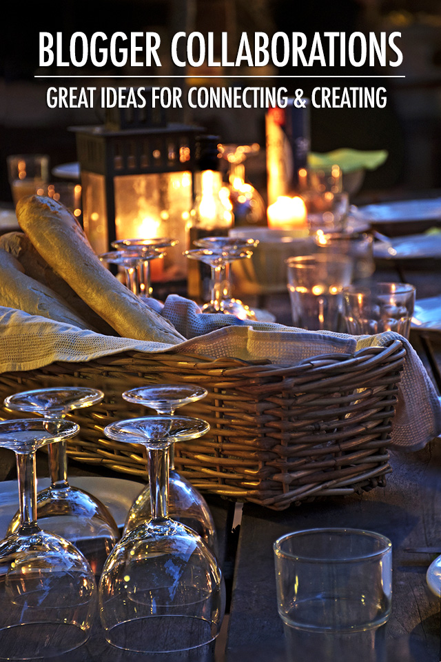prepared table for a rustic outdoor dinner at night with wineglasses bread and candles vertical