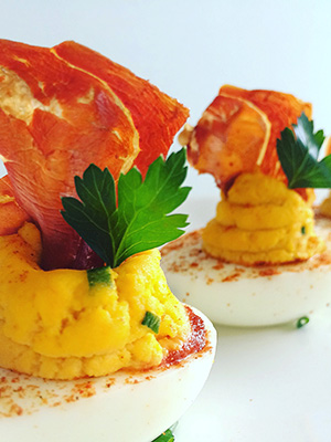 Sriracha Deviled Eggs with Crispy Serrano Ham | Everyday on Occasion