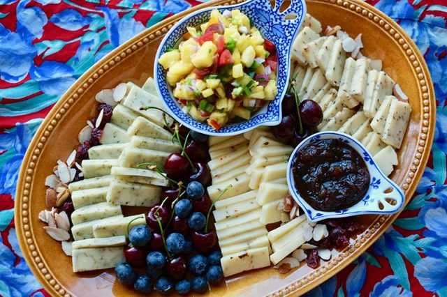 Summer cheese platter cheeses, jams, fruit and chutney