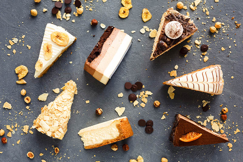 different types of pieces of cake on a table