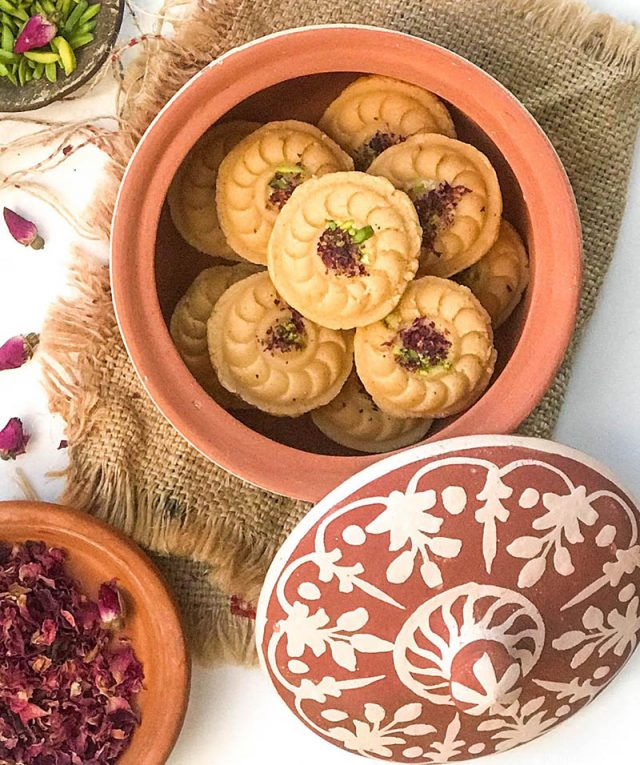 A terra cotta jar full of rose flavoured ricotta cheese shondesh