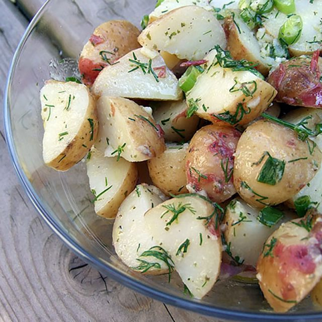 Herbed Potato Salad in a glass bowl