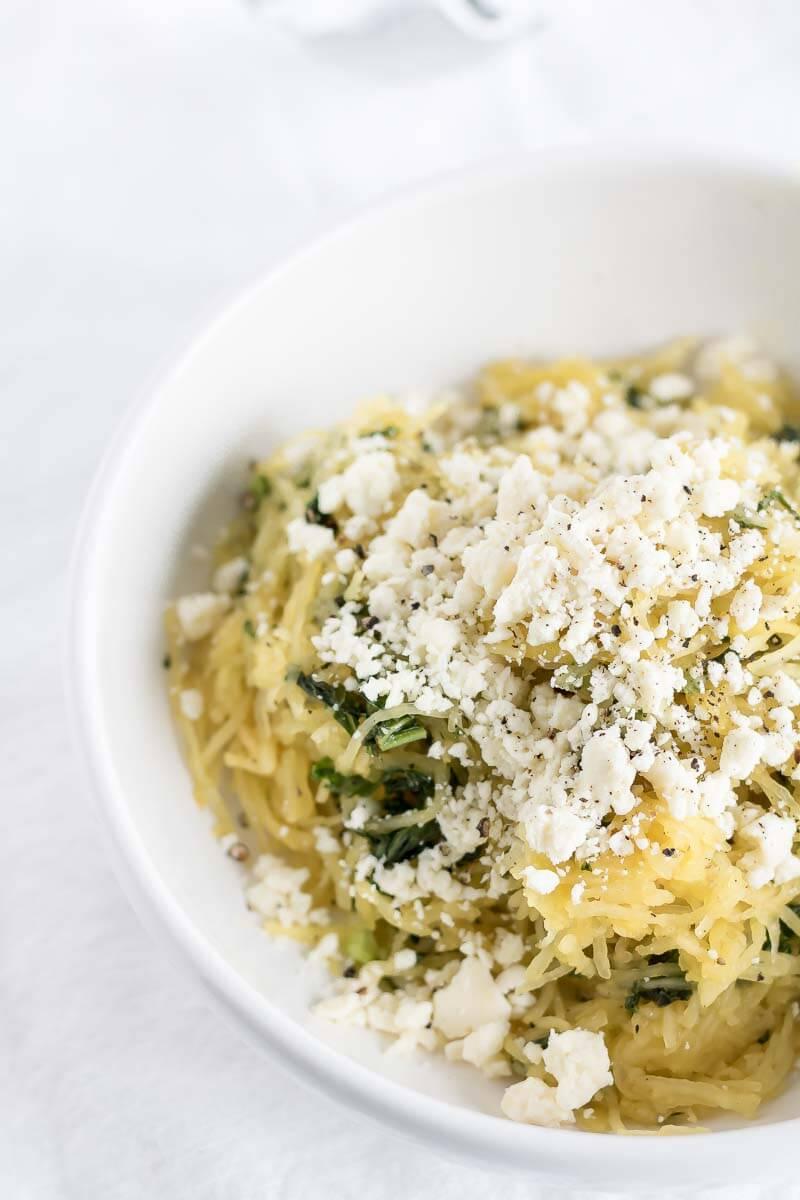 Spaghetti squash in a bowl with feta and kale