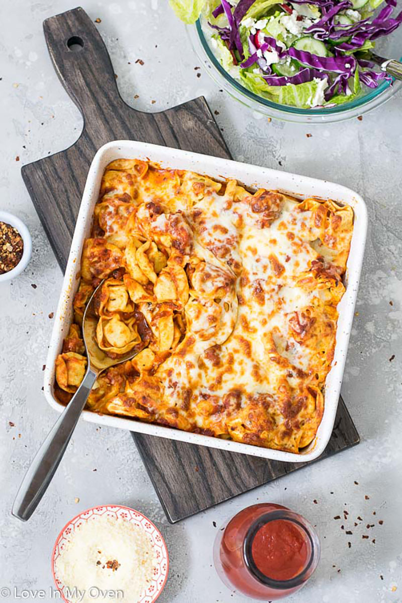 A casserole dish of cheesy baked tortellini