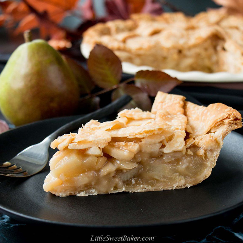 A slice of pear pie on a plate