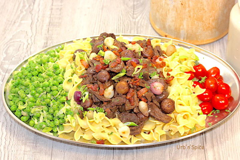 plated beef bourguignon with noodles and veggies