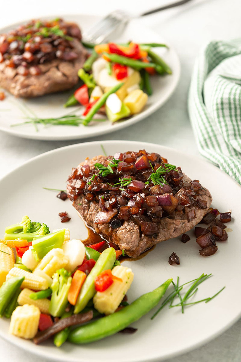 Chaliapin steak on a plate with mixed veggies