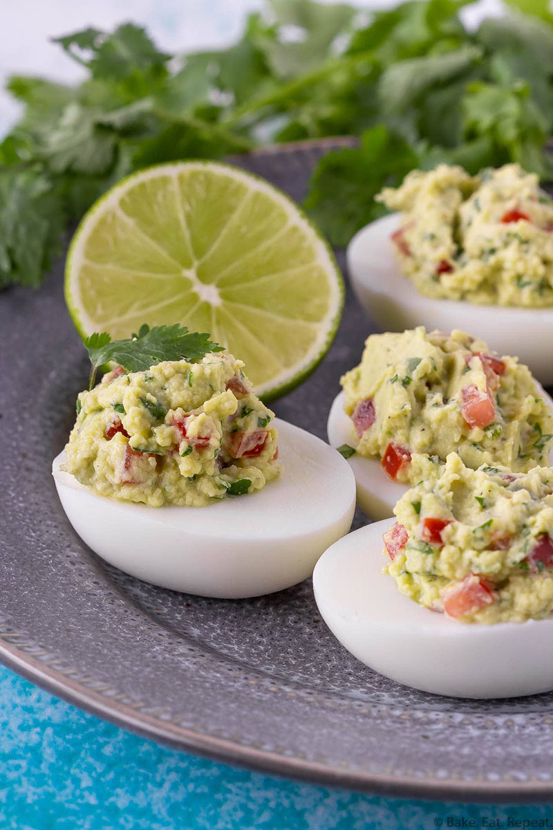 a plate of guacamole deviled eggs