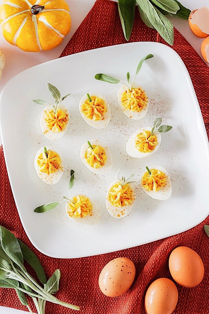 A plate of pumpkin patch deviled eggs