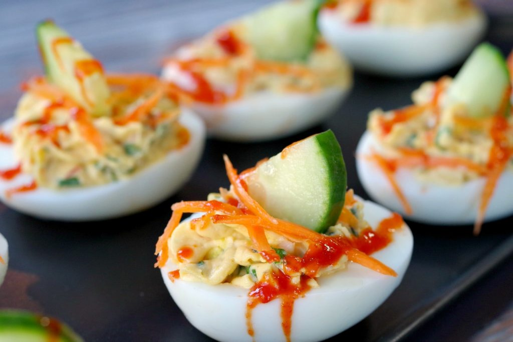 a plate of banh mi style deviled eggs