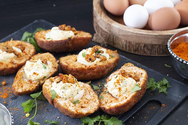 a tray of tandoori scotch deviled eggs