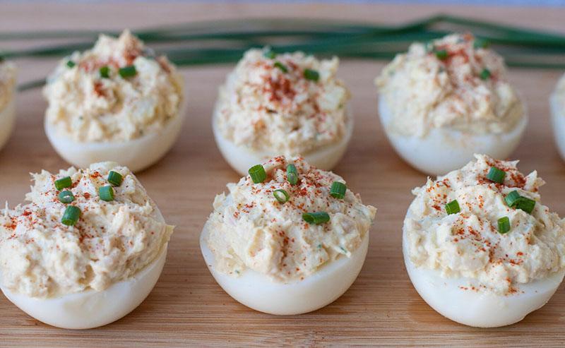 a tray of tuna salad deviled eggs